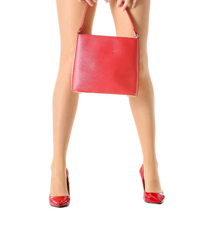 Photo pour Beautiful young woman in tights and with bag on white background - image libre de droit