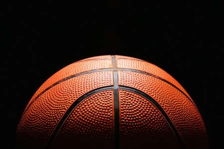 Foto de Ball for playing basketball on dark background, closeup - Imagen libre de derechos