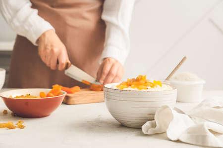 Photo pour Woman preparing tasty rice in kitchen, closeup - image libre de droit