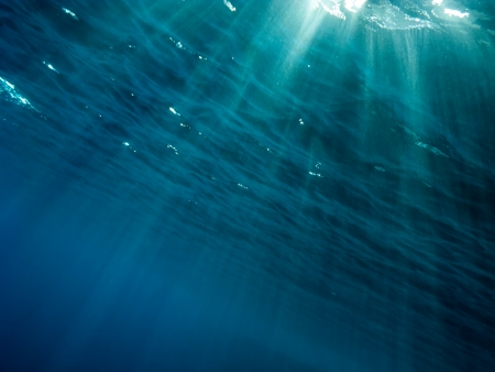 The underwater picture with the rays of light from the surface to depth