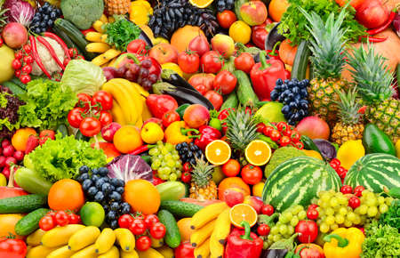 Foto de Assorted fresh ripe fruits and vegetables. Food concept background. Top view. Copy space. - Imagen libre de derechos