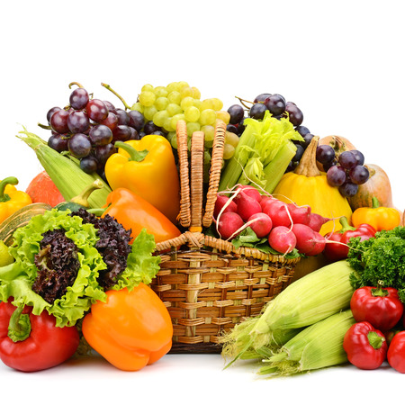 Photo for Healthy vegetables and fruits in willow basket isolated on white - Royalty Free Image