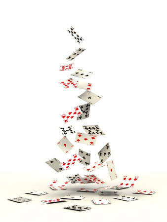 Playing cards falling on white background