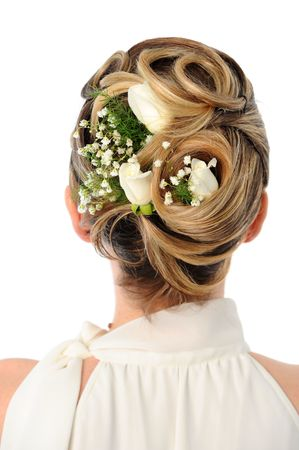 Back view of elegant wedding hairstyle with roses