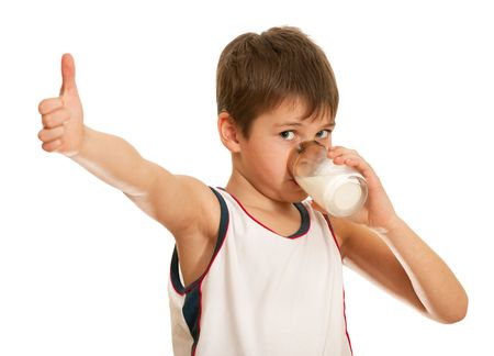 A drinking milk boy is showing his tumb up; isolated on the white background