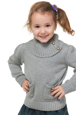 A portrait of a fashion little girl in grey sweater; isolated on the white background