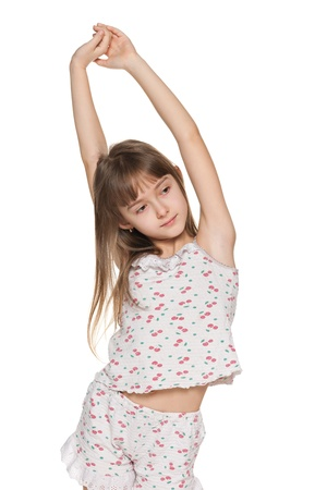 A young girl stretches himself in the morning; on the white background