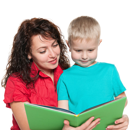 A portrait of a smiling mother with her son reading a book