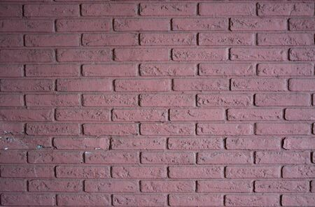 Old brick wall colorfully painted
