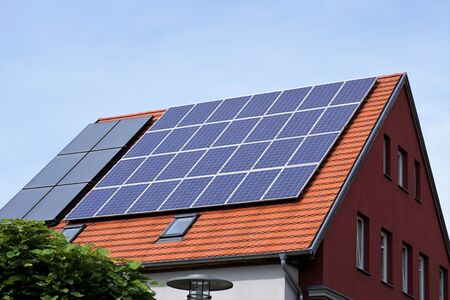 Photo for Ecological and renewable solar energy panels on the roof of a house - Royalty Free Image