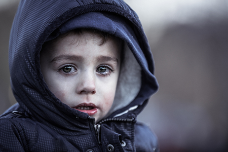 Photo for poor child - Royalty Free Image