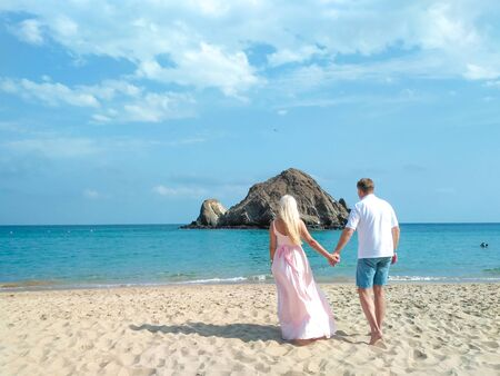 Photo for Married couple on the ocean look into the distance. - Royalty Free Image