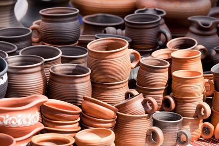 Rustic handmade ceramic clay brown terracotta cups souvenirs at street handicraft market