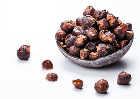 Photo pour soap nuts on a white background in the coconut. - image libre de droit