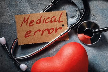 Foto de Medical error concept: stethoscope and heart shaped object, close-up - Imagen libre de derechos