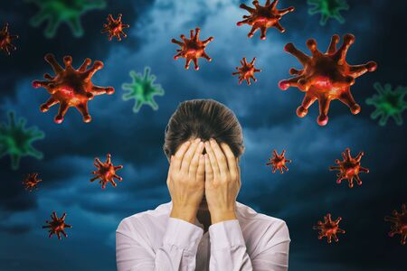 Photo for The girl closed her face with her hands against the background of a thunderstorm sky with a coronavirus. The concept of fear of the pandemic COVID-19 - Royalty Free Image