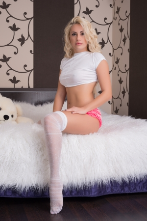 Fashion portrait of young blonde girl in lingerie