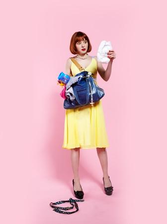 Photo pour portrait of surprised redhead woman looking at diaper - image libre de droit