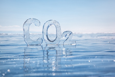Chemical formula of greenhouse gas carbon dioxide CO2 made from ice on winter frozen lake Baikal under blue sky