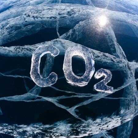 Chemical formula of greenhouse gas carbon dioxide CO2 made from ice on winter frozen lake Baikal