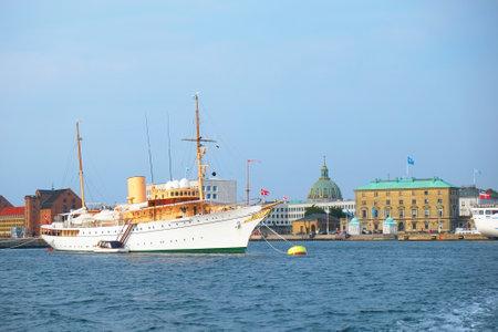The Royal ship of Danish queen is in the harbour in front of Amalienborg in Copenhagen, Denmark.