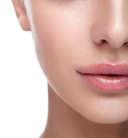 Foto de Half face female beauty portrait with healthy skin and Rose Quartz color lips - Imagen libre de derechos