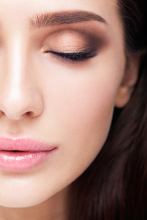 Photo for Half face female beauty portrait with makeup in aqua Limpet Shell color eye shadows, Snorkel Blue colour liner and Rose Quartz lips - Royalty Free Image