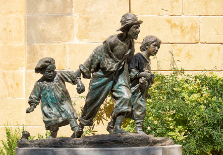 Valletta, MALTA - JULY 24, 2015: Sculpture of Gavroshe  with brothers in the Upper Barrakka Gardens - replica of the statue of Victor Hugos novel character by Maltese sculptor Antonio Sciortino.