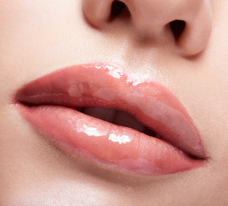 Closeup shot of female mouth with red lips color