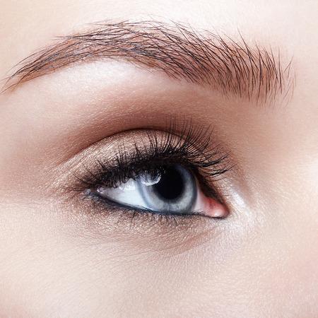 Photo pour Closeup macro shot of blue human woman eye. Female with smoky eyes makeup - image libre de droit