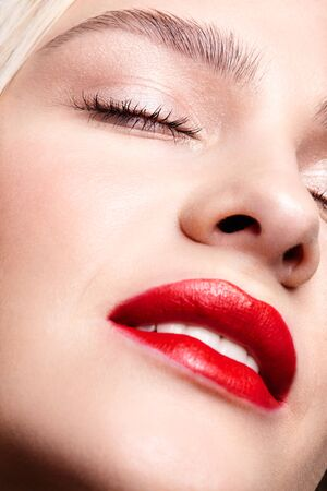 Photo pour Closeup macro portrait of female part of face. Human woman with red smiling lips and beauty makeup. Eyes closed. - image libre de droit