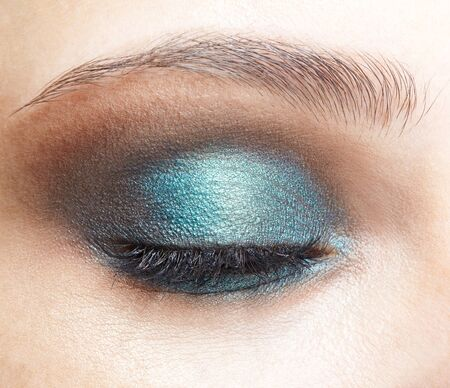 Photo for Closeup macro shot of closed human female eye. Woman with natural evening vogue face beauty makeup. Girl with perfect skin and  blue  eyes shadows - Royalty Free Image