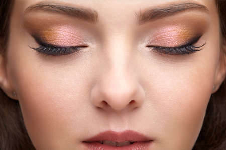 Photo pour Closeup portrait of female part of face. Human woman with red lips and smoky eyes beauty makeup. Eyes closed - image libre de droit