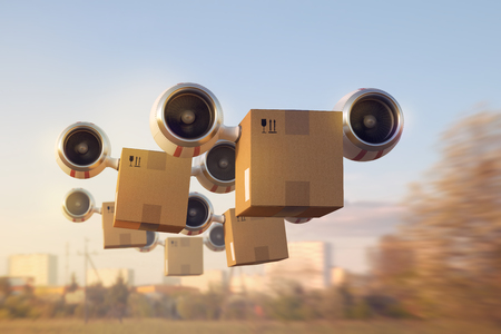 Foto de The chain of flying on turbines cardboard boxes illustrate the fast delivery of goods - Imagen libre de derechos