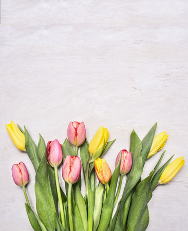 Photo pour bouquet of colorful spring tulips on wooden rustic background top view close up border ,place for text - image libre de droit
