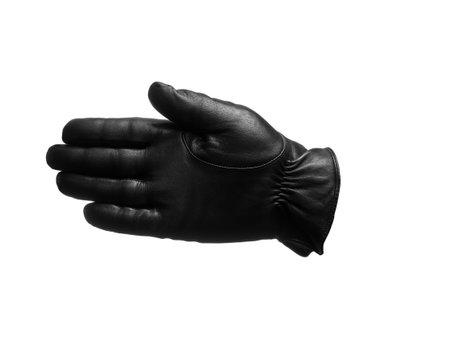 Photo pour black leather glove shows open palm left gesture. isolated white background. - image libre de droit