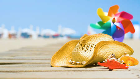 Photo for Beautiful summer holiday beach background with straw hat and seashells. Summer concept with accessories on the sandy beach - Royalty Free Image