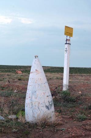 Improvised road sign made of missile head. Remains of incription - Rest Area Balkhash (RU) .Former Soviet anti-ballistic missile testing range Sary Shagan. May 7, 2017.Priozersk.Kazakhstan
