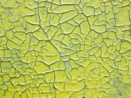 Surface covered with cracked paint in the background