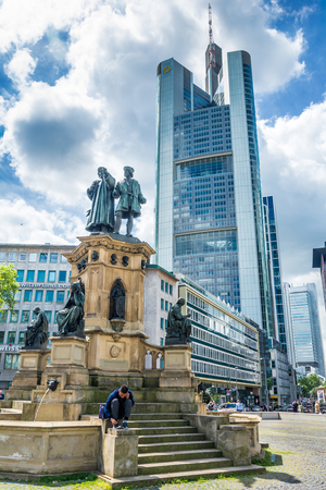 FRANKFURT AM MAIN, GERMANY - MAY 19, 2016: The Johannes Gutenberg monument on the southern Rossmarkt (1854 - 1858, by sculptor Eduard Schmidt von der Launitz). Johannes Gutenberg - inventor of book printing. Frankfurt am Main, Germany.