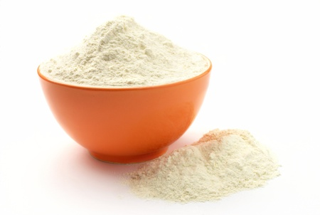 flour in a bowl on a white background isolated