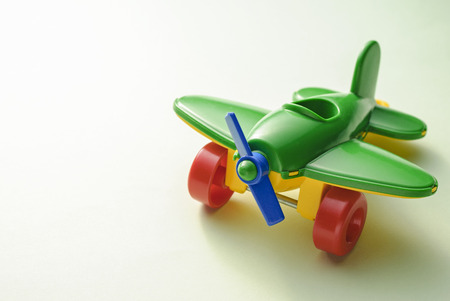 Photo pour Childrens toy green plane on a gradient green background - image libre de droit