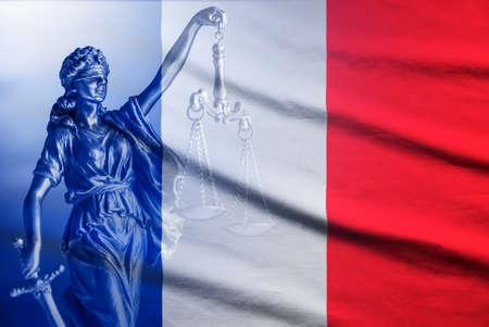 Foto de National flag of France with a statue of Justice - Imagen libre de derechos