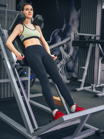 Photo for Young girl makes exercises at the gym - Royalty Free Image