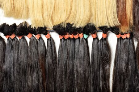 Photo for Haircare female hair, technology, style and beauty concept. Natural black and white, brown, shiny, colored shiny healthy human hair bundles for extension and weave wigs making. - Royalty Free Image