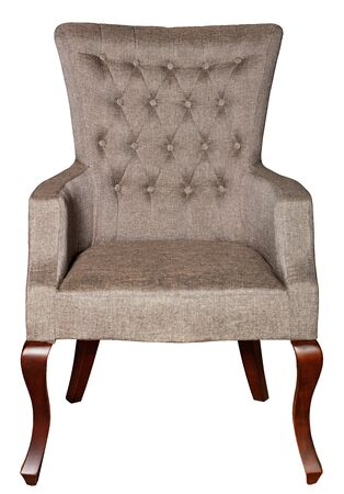 A wooden soft armchair upholstered in brown textile upholstery with bent curly legs, photographed frontally, isolated on a white background.