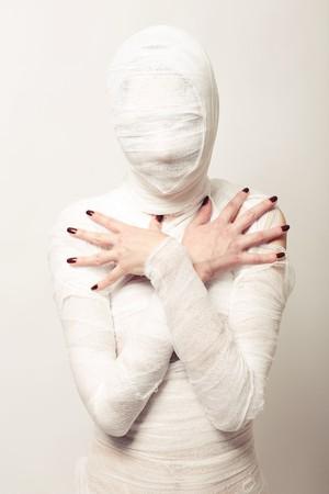 Girl dressed as a bandaged mummy