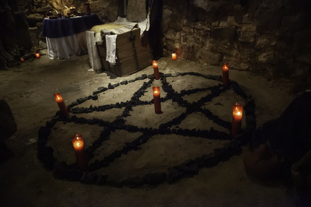 Photo for Satanic pentacle with lighted candles, dark magic ritual detail, occultism - Royalty Free Image