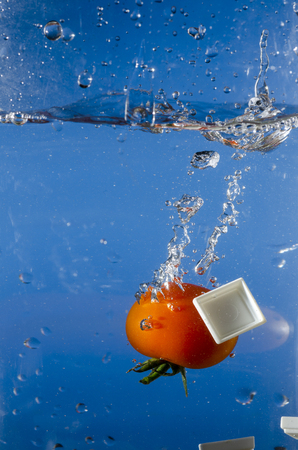 tomato falling into the water still life
