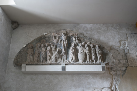 14th century stone lunette depicting the crucifixion kept in the church of Sant'Andrea Apostle in Ve ...